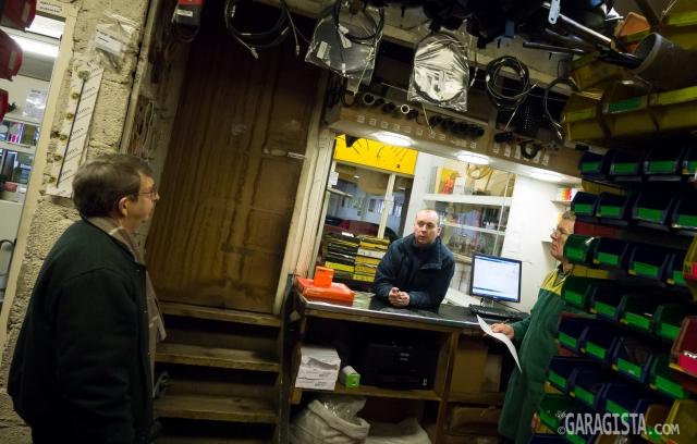 John Crook (left) greets customer