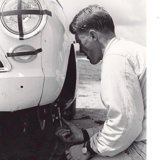 Dan Gurney repairs his Lotus Cortina